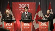 Federal Liberal Party leadership candidates Martha Hall Findlay (left), Justin Trudeau and Martin Cauchon (right) share a laugh during a leadership candidates debate in Halifax on March 3, 2013. (REUTERS)