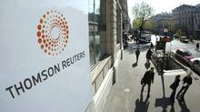 The Thomson Reuters logo is seen in Paris. The news and information company has reported first-quarter earnings of $314-million or 41 cents a share, compared with $272-million or 34 cents a year ago. (JACKY NAEGELEN/REUTERS)