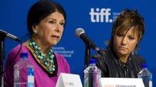 """Director Alanis Obomsawin of Hi-Ho Mistahey! speaks during the First Peoples Cinema press conference while director Sarah Spillane of """"Around The Block"""" looks on at the 2013 Toronto International Film Festival in Toronto on Friday, Sept. 6, 2013. (Galit Rodan/THE CANADIAN PRESS)"""