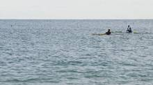 Kayakers paddle north in Lake Huron on March 9, 2017, at Lighthouse Beach in Port Huron, Mich. (MARK R. RUMMEL/AP)