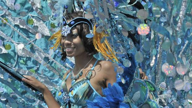 Revelers take part in the Scotiabank Caribbean Carnival Parade on the lakeshore in Toronto, August 3, 2013. (J.P. MOCZULSKI for The Globe and Mail)