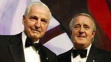 Paul Desmarais, left, is pictured with former Canadian prime minister Brian Mulroney in Montreal in 2003. Desmarais, who passed away Tuesday at 86, was a quiet force in Canadian politics and engaged leaders of all political stripes. (Christinne Muschi/Reuters)