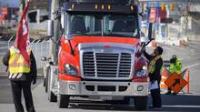 "More than 300 unionized truck drivers manned picket lines at Port Metro Vancouver March 10 with the goal of ""crippling"" container traffic. (John Lehmann/The Globe and Mail)"