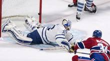 Montreal Canadiens' Michael McCarron, right, scores past Toronto Maple Leafs' goalie Antoine Bibeau during first period NHL pre-season hockey action Tuesday, September 22, 2015 in Montreal. (Paul Chiasson/THE CANADIAN PRESS)