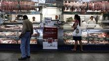 A woman shops at the the Municipal Market in Sao Paulo. (NACHO DOCE/REUTERS)