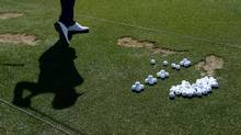 Golfer hitting golf balls on the range (MATT SULLIVAN)