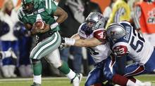 Saskatchewan Roughriders quarterback Darian Durant runs for a touchdown past Montreal Alouettes linebackers Shea Emry (centre) and Ramon Guzman during fourth quarter Grey Cup action in Calgary, Sunday November 29, 2009. (Adrian Wyld/The Canadian Press)