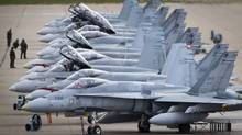 CF-18's in CFB Cold Lake, AB September 28, 2010 are line up on the tarmac before take off. (John Lehmann/The Globe and Mail)