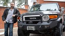 Entrepreneur and CBC's Dragon's Den Judge Brett Wilson with his favorite vehicle, a Toyota FJ Cruiser with lots of upgrades and modifications, in Calgary, Alta., Tuesday, Nov. 16, 2010.(Jeff McIntosh/Globe and Mail)