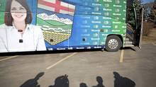 Members of the media wait for Danielle Smith, leader of the Wildrose party, to exit her bus at a campaign stop in Calgary (in Redford's riding) April 20, 2012. (John Lehmann/Globe and Mail)