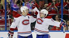 Montreal Canadiens' David Desharnais, right, celebrates a goal with teammate Josh Gorges during the first period of an NHL hockey game in Tampa, Florida February 28, 2012. (Reuters)