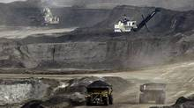 Many investors fear falling crude prices will slash the profit margin on oil sands crude, and stall further development. AP Photo/Jeff McIntosh (JEFF MCINTOSH/AP)