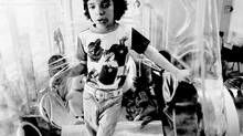 David Vetter, born with an inherited disorder, which leaves him no natural immunities against disease, is shown in this Dec. 17, 1976 file photo in Texas. In 1984, Vetter died from complications of an experimental bone marrow transplant, thought to be his only chance at survival outside his bubble. (AP Photo/File)