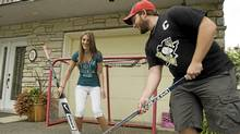 Florence, left, and Olivier Dallaire-Turmel, right, aged 18 and 20 played hockey at home (CLEMENT ALLARD/Clement Allard for The Globe and Mail)