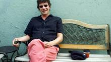 Paul Westerberg relaxes on a bench outside a coffee shop during an Aug. 17, 2004 interview with The Associated Press in Minneapolis. (JIM MONE/Associated Press)