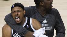 Paul Pierce with teammate Andray Blatche during a 2014 playoff game. Pierce has announced that this season will be his last in the NBA. (Nathan Denette/THE CANADIAN PRESS)