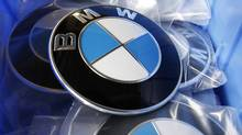 File photo of BMW luxury car logo's in a spare part store at a BMW garage in Niderwangen near Bern, May 24, 2012. (Pascal Lauener/Reuters)