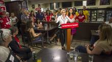 Ontario Liberal Leader Kathleen Wynne used a campaign stop at Curozo Gourmet Pizza in Bolton, Ont., to criticize PC Leader Tim Hudak and link him with Toronto Mayor Rob Ford. (Chris Young/THE CANADIAN PRESS)