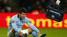 Manchester City's Sergio Aguero reacts after being injured during their English Premier League soccer match against Stoke City at The Etihad stadium in Manchester, northern England, January 1, 2013. Aguero confirmed on Saturday that he has suffered a torn hamstring and is likely to miss next weekend's Premier League trip to Arsenal. (DARREN STAPLES/REUTERS)