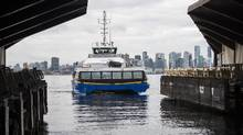 A TransLink SeaBus arrives at the Lonsdale Quay SeaBus station in North Vancouver. Vancouver TransLink stopped bus service over the Lions Gate Bridge due to traffic caused by construction. (Jimmy Jeong For The Globe and Mail)