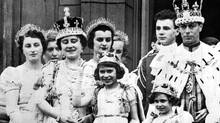 FILE- Members of the British royal family gather on the balcony of Buckingham Palace in London after the coronation of King George VI, in this May 12, 1937 file photo. Princess Margaret, front right, died peacefully in her sleep at King Edward VII Hospital in London on Saturday Feb. 9, 2002, aged 71. Others shown on balcony are Queen Elizabeth (now the Queen Mother) with crown second left, Princess Elizabeth (now Britain's Queen Elizabeth II) at front center waving. Others are unidentified. (Associated Press)