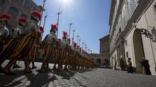 Vatican Swiss guards march prior to a swearing-in ceremony, at the Vatican, Tuesday, May 6, 2014. (Alessandra Tarantino/AP)