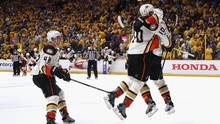 Corey Perry (#10) of the Anaheim Ducks celebrates with teammates after scoring the game-winning goal in overtime. (Bruce Bennett/Getty Images)