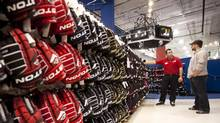 Shopping for hockey equipment at a Pro Hockey Life Sporting Goods in Vaughan, Ontario on Nov. 28, 2012. (Tim Fraser For The Globe and Mail)