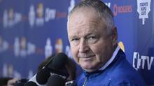 Randy Carlyle, head coach of the Toronto Maple Leaf hockey team holds a media scrum after training camp at the MasterCard Centre on Sept 12 2013. (Fred Lum/The Globe and Mail)