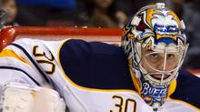 Buffalo Sabres goalie Ryan Miller makes a blocker save against the Vancouver Canucks during the first period of an NHL hockey game in Vancouver, B.C., on Saturday March 3, 2012. (CP)