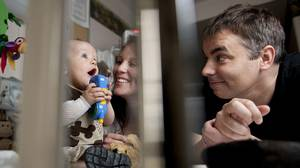 Berlin heart recipient Chace Campsall, 10 months, plays with his parents Christa Campsall and Anthony Herman, right, at the Stollery Children's Hospital left, in Edmonton, on June 16, 2010.