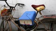 A bible is placed on a bicycle saddle at an underground Catholic church in Tianjin November 10, 2013. (Kim Kyung Hoon/REUTERS)