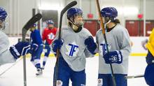 Sena Suzuki, left, practices with the Toronto Furies of the Canadian Women's Hockey League on Jan. 6. Suzuki was selected alongside many of the league's big-name players for the all-star game on Jan. 23. (Galit Rodan for The Globe and Mail)