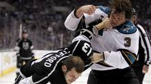 Los Angeles Kings winger Kyle Clifford is punched by San Jose Sharks defenceman Douglas Murray during the second period of an NHL hockey game, Saturday, March 16, 2013, in Los Angeles (CP/AP)