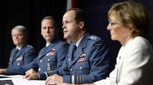 General Tom Lawson, second from right, Chief of the Defence Staff, speaks at a news conference in Ottawa on Thursday, April 30, 2015 following the release of an inquiry into sexual misconduct in the Canadian Forces. Marie Deschamps, a former Supreme Court justice and the report's author is at right, Lieutenant-General Whitecross is at left and Chief Warrant Officer Kevin West is second from left. (Adrian Wyld/THE CANADIAN PRESS)