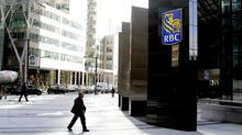 As Canada's biggest banks prepare to roll out a parade of first-quarter earnings this week, new data suggest a telltale drop in consumer lending is starting to rear its head – brought on by tighter mortgage-lending rules and high household debt, which is crimping borrowing. (Fernando Morales/The Globe and Mail)