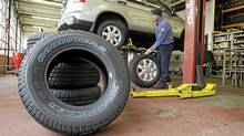 Tire rotation is an often-overlooked routine maintenance procedure, which can help extend the life of tires, and improve handling. (Mark Duncan/AP)