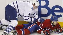 Montreal Canadiens' Max Pacioretty is dumped by Toronto Maple Leafs defenceman Dion Phaneuf during first period NHL hockey action Thursday, February 24, 2011 in Montreal. THE CANADIAN PRESS/Paul Chiasson (Paul Chiasson)