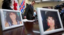 Photos of Robert Pickton victims Diane Rock, left, and Cara Ellis are displayed as British Columbia NDP leader Adrian Dix, centre, and Lilliane Beaudoin, Diane Rock's sister, arrive for a news conference in Vancouver, B.C., on Thursday March 29, 2012. (DARRYL DYCK/THE CANADIAN PRESS)