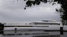 In this Tuesday Oct. 30, 2012 file photo, a yacht is docked at the wharf of ship building company Royal De Vries in Aalsmeer, near Amsterdam, Netherlands. The sleek, white superyacht Apple founder Steve Jobs commissioned before his death cannot leave the Netherlands just yet due to a payment dispute. (Peter Dejong/AP)