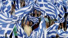 Greek conservative party supporters wave flags during a pre-election rally by their leader Antonis Samaras in the town of Thessaloniki May 2, 2012 (GRIGORIS SIAMIDIS)