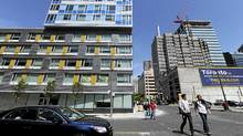 The YWCA Elm Centre, left, has 300 units with 100 subsidized units set aside for women with health and mental issues. (Fred Lum/The Globe and Mail/Fred Lum/The Globe and Mail)