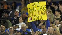 A Toronto Blue Jays fan holds up a sign thanking the players during the team's last home game of the season against the Los Angeles Angels on Sept. 22, 2011. (Mike Cassese/Reuters)