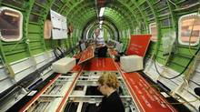 Workers lay cables and wiring in a Global Express jet being manufactured at Bombardier Inc.'s Downsview assembly plant on May 29 2012. (Fred Lum/Fred Lum/The Globe and Mail)