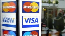 Credit cards with magnetic stripes, including many Visa and Mastercard cards, remain vulnerable to fraud. (Michael Probst/The Associated Press)