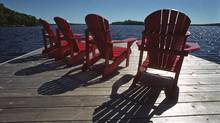Muskoka chairs on a Lake Muskoka cottage dock. (Fred Lum/Fred Lum/THE GLOBE AND MAIL)