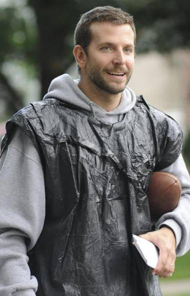Pat (Bradley Cooper) dons a garbage bag to go running