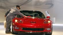 A worker polishes the hood of a 2011 Chevrolet Corvette ZR1 (Jim Prisching/AP2010)