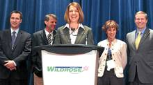 Wildrose Alliance Leader Danielle Smith, centre, is all smiles as she unveils the party's new logo to kick off the upstart provincial party's annual convention in Red Deer, Alta., Friday. (Randy Fielder/CP)