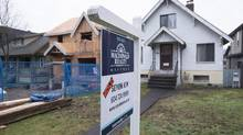 A sold home is pictured in Vancouver, B.C., Thursday, Feb. 11, 2016. Prospective buyers and neighbours have long complained that investors are buying houses and leaving them empty, driving up prices and reducing supply, but there's been little data to back up the claims. (JONATHAN HAYWARD/THE CANADIAN PRESS)